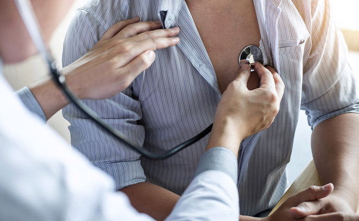 doctor checking heart