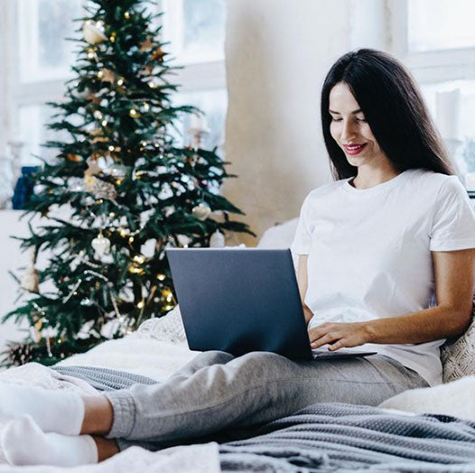 woman in bed on laptop