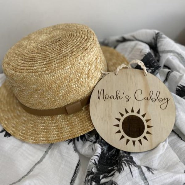 laser cut circular wooden name plaque with sunshine detail
