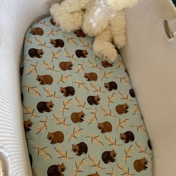 blue bassinet sheet with wombats