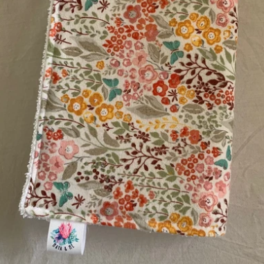 burp cloth with pink and yellow flowers