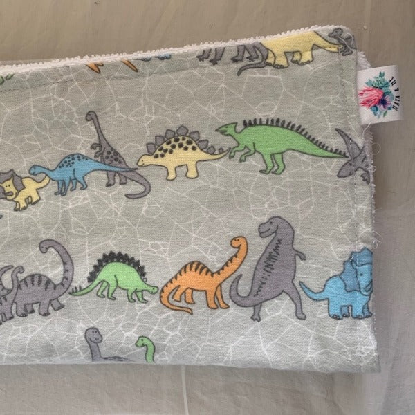 dinosaur pattern burp cloth with grey background