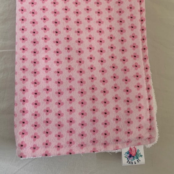 pink burp cloth with small pink flowers