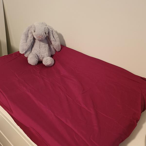 Plum baby change mat with toy bunny