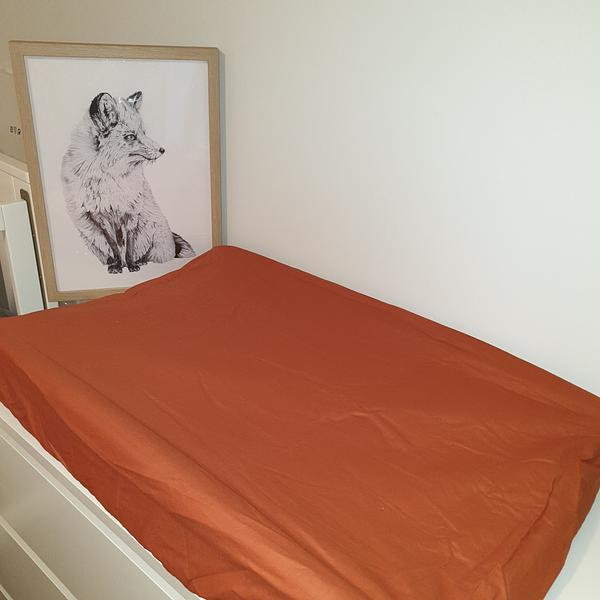 Rust orange change mat with fox frame