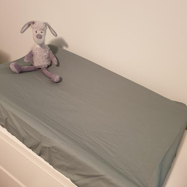 sage colour baby change mat with toy sheep