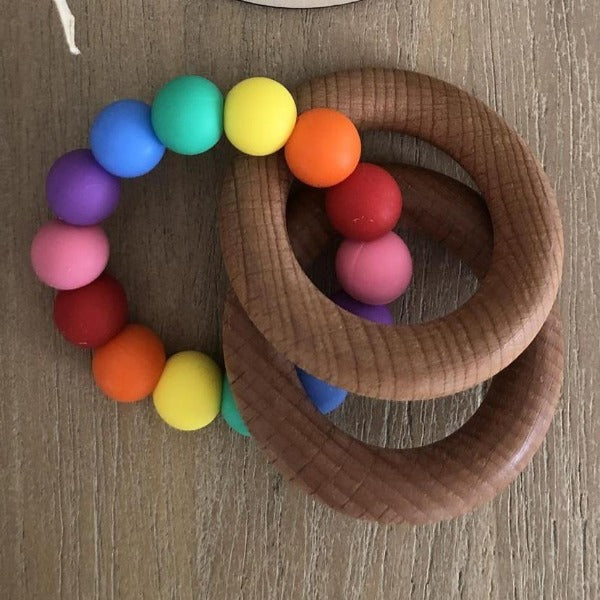 wooden teether ring with bright rainbow silicone beads