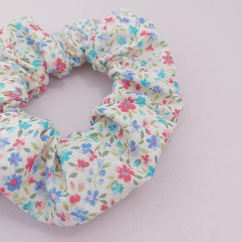 floral scrunchie with small blue and pink flowers
