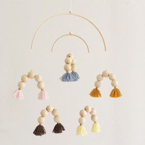 wooden baby cot mobile with colourful rainbow beads and tassels