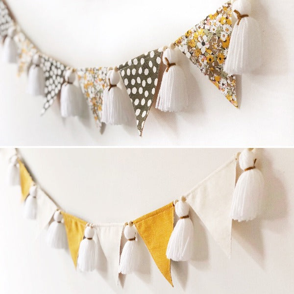 image of both sides of mustard and floral baby bunting hanging on the wall