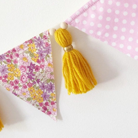 polka dot and floral bunting hanging on the wall