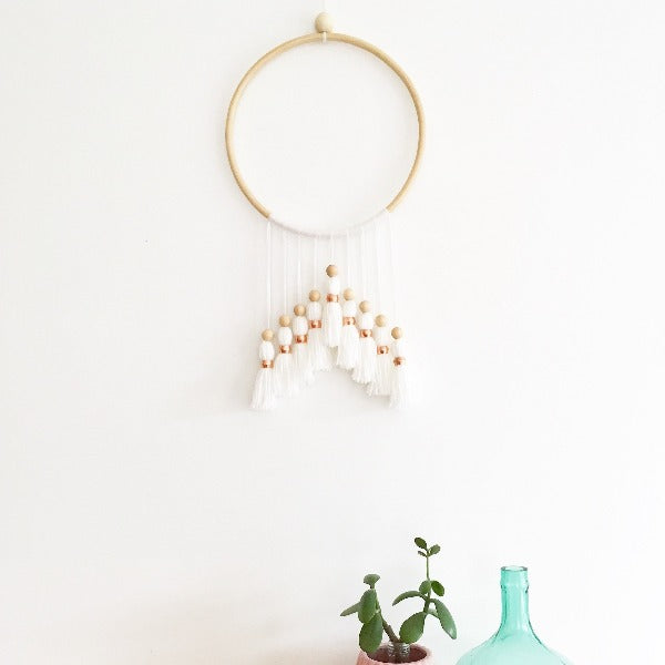 beautiful white tassel wall art with wooden hoop and brass beads