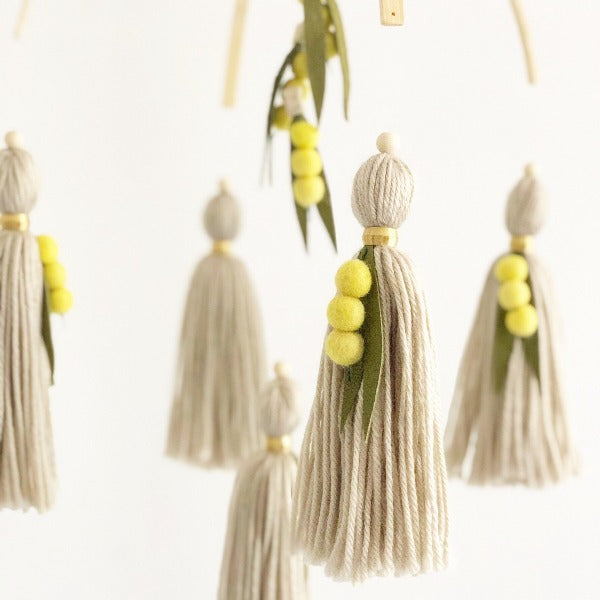 close up of tassle on beautifully handmade baby mobile australiana wattle tree