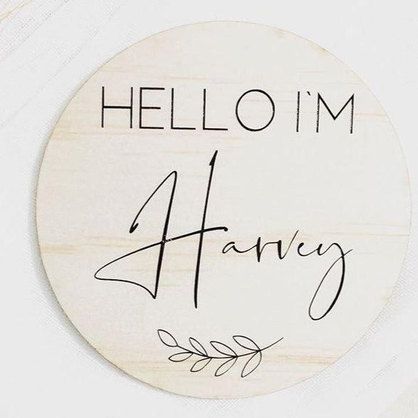 Round wooden name plaque that reads Hello I'm Harvey name plaque