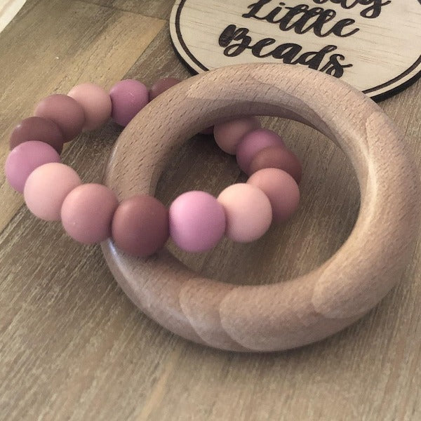 wooden teether ring with earthy pink silicone beads