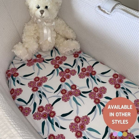 teddy bear in a bassinet with a beautiful handmade eucalyptus fitted bassinet baby sheet baby bedding