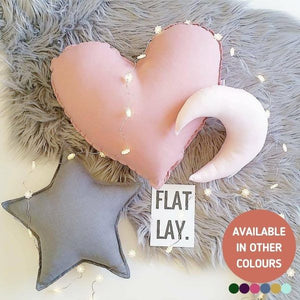 Pink heart, grey star and light pink mood cushion on grey fur rug with fairy lights