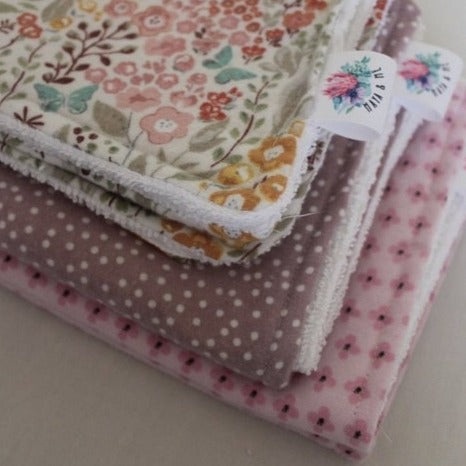 stack of 3 pink burp cloths with flowers and dots