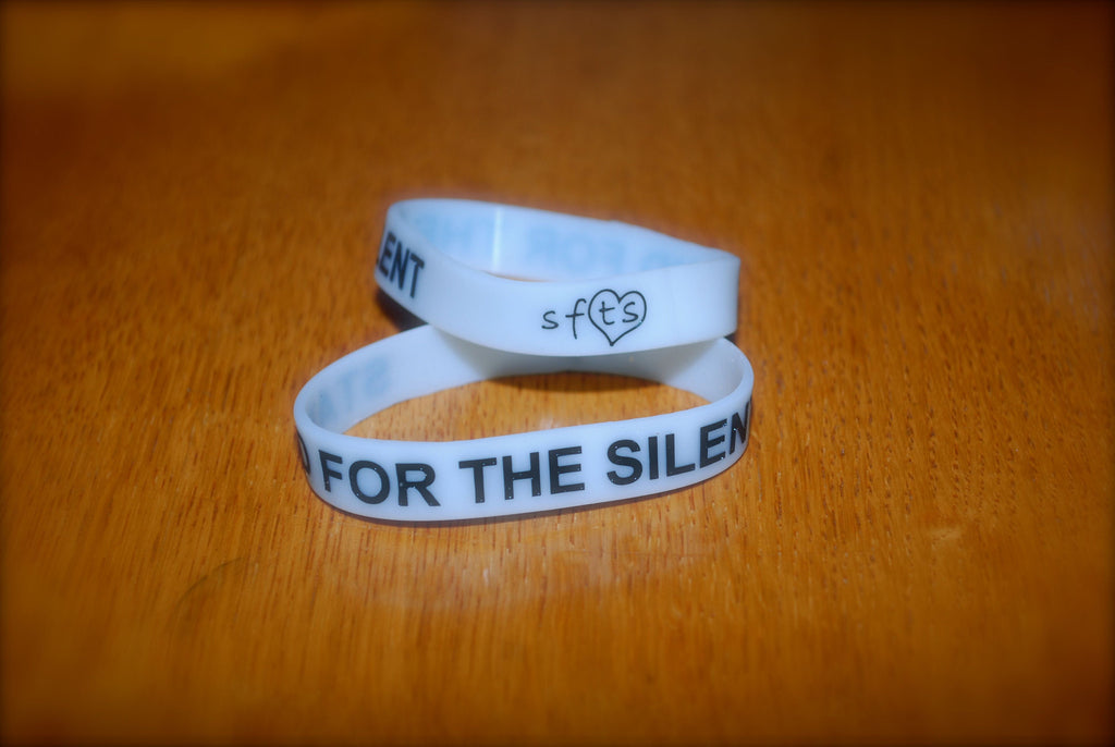 Glow In The Dark White w/ Black Letters Wristband