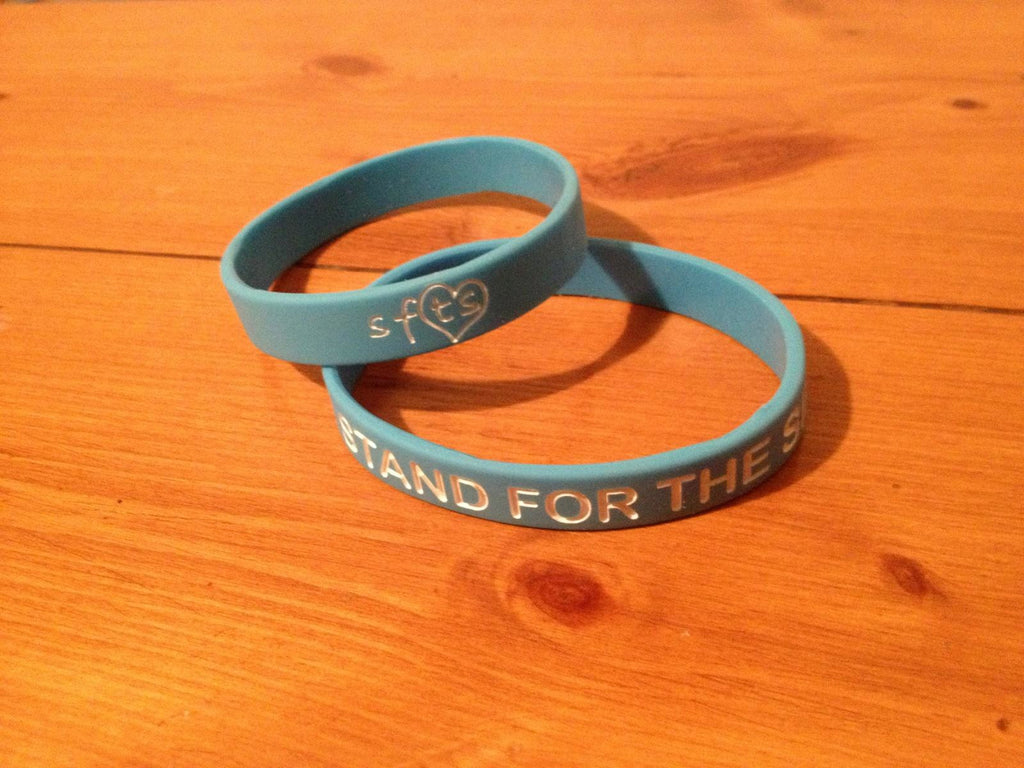 "Light Blue ""Stand For The Silent"" w/ White Letters Wristband"