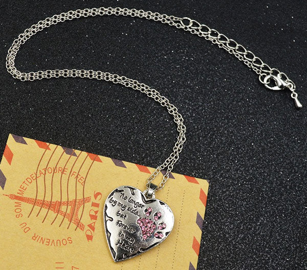 heart neckless black background