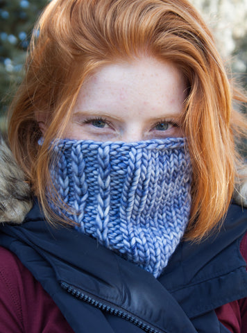 A snuggly blue cowl with super bulky handdyed blue yarn