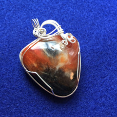 Blue Apatite in Orange Calcite Sterling Silver Wire Wrapped Pendant