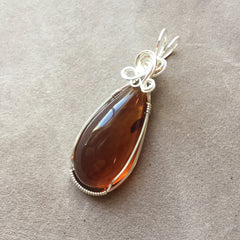 Dark Amber Sterling Silver Wire Wrapped Pendant
