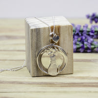 The cat and the moon pendant