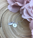 Tiny initial disc with leaf necklace