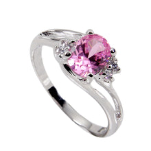 Load image into Gallery viewer, Offset Twist Sterling Silver Ring With Oval Pink Cubic Zirconia Center Stone