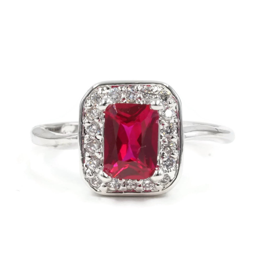 Silvertone Fashion Ring with Emerald Cut Synthetic Ruby and CZ border