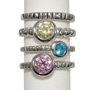 Set of Four Stackable Fashion Rings With Pastel Cubic Zirconia