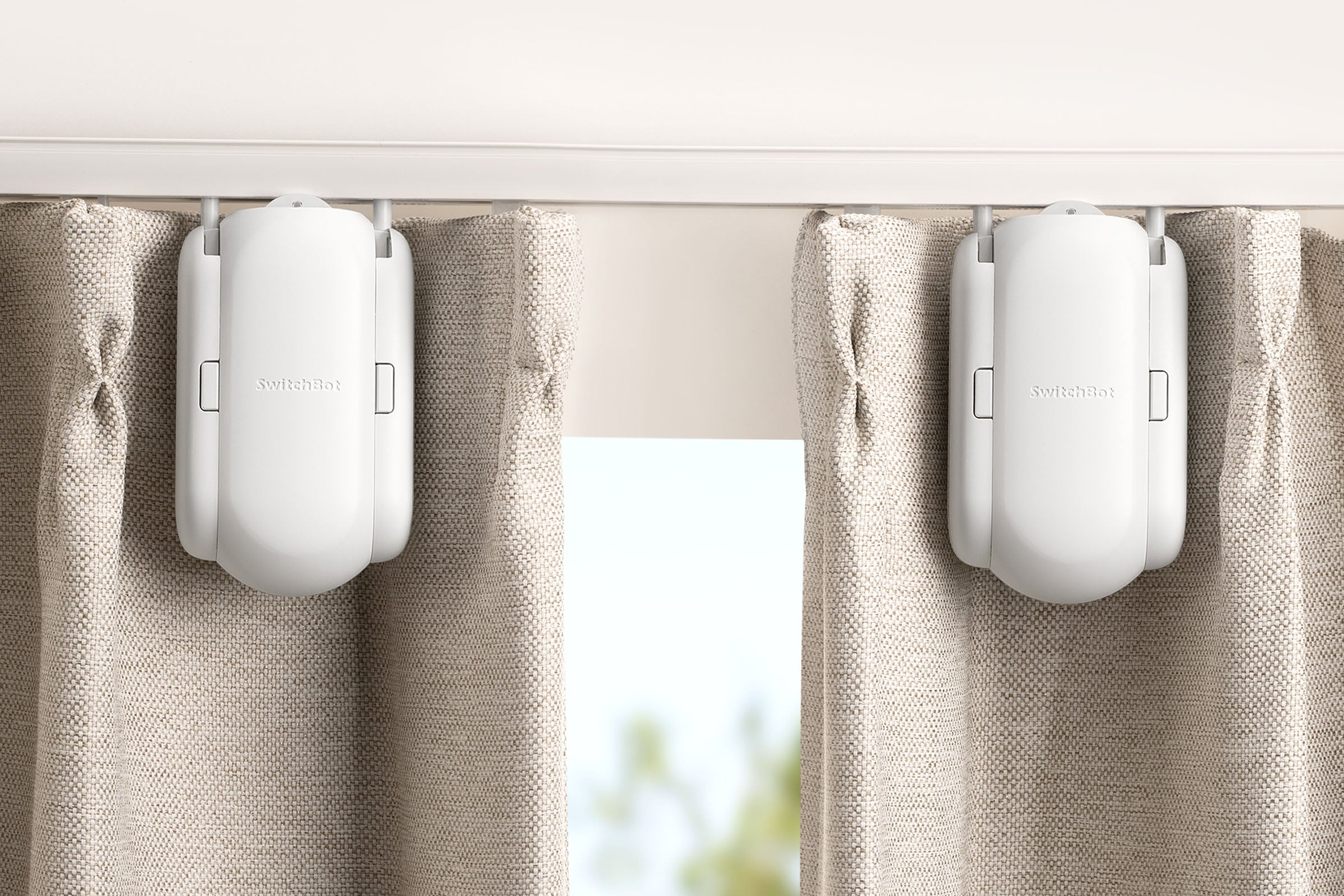 You can get SwitchBot Curtain Starter Pack (two units) so to open and close your double-sided curtains from the middle. By just a simple setup in the App, two curtains will run as one on the track.
