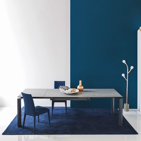 Esteso extendable dining table staged