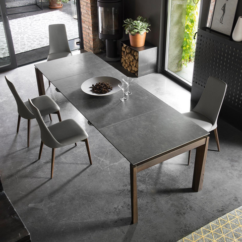 Esteso extendable dining table staged with lead grey top