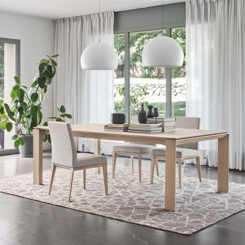 calligaris omnia 180 extendable wood dining table staged in natural