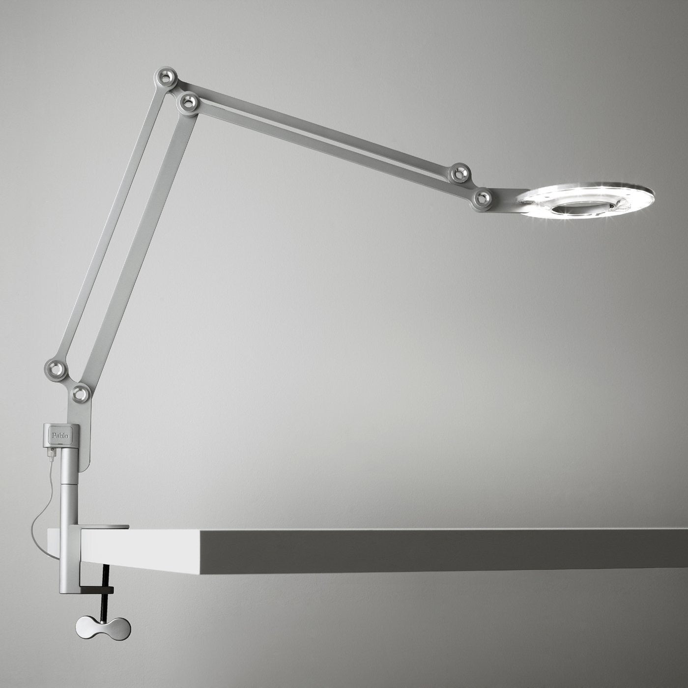 light en table modern and lighting p clamp tavolo cache fortebraccio with luceplan