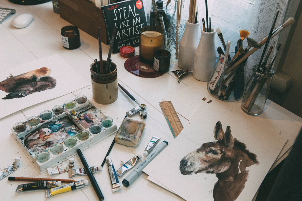 Paints and paint palette on Marie Wade's Desk