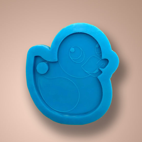 Rubber ducky silicone mold with a bold green back