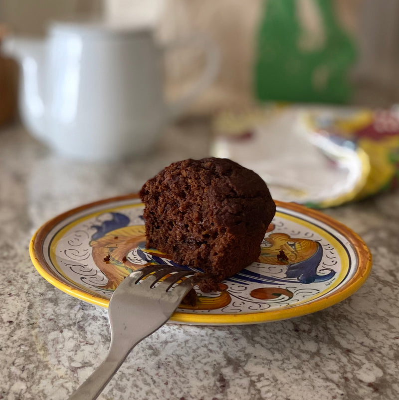 Moist and delicious zucchini double chocolate muffin on a beautiful plate.