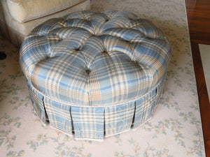 BLUE, TAN AND CREAM PLAID TUFTED OTTOMAN WITH A BOX PLEAT SKIRT