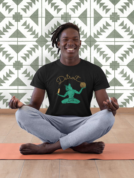 Smiling Black Male Doing Yoga Wearing a Black Spirit of Detroit Cat T-Shirt | I Club Detroit