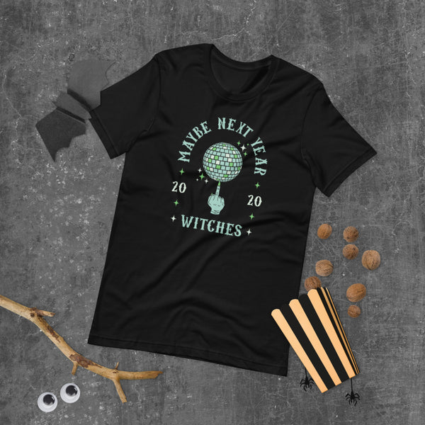 Halloween themed Flat Lay of Black Graphic Tee with Witches Finger spinning Disco Ball | I Club Detroit