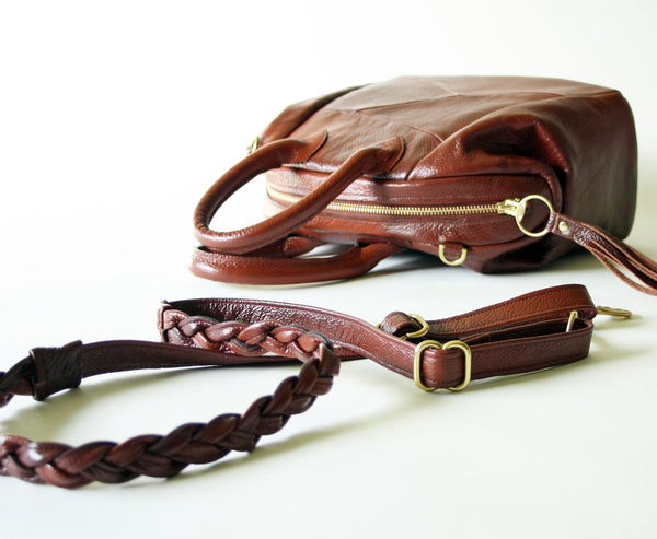 beautiful handmade brown leather bag with braided strap