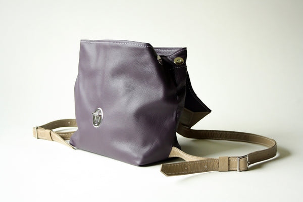 Backpack in plum + tan with deco detail