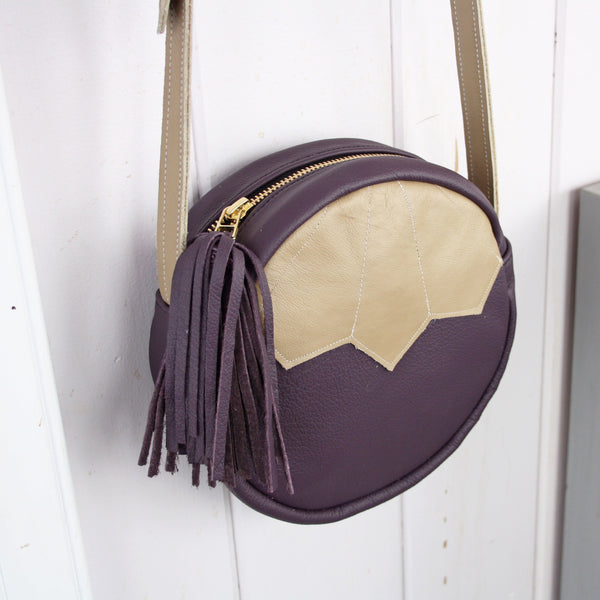 purple art deco leather round bag