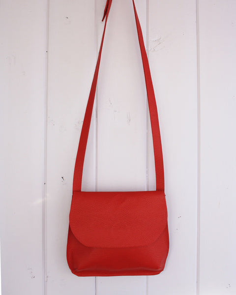 modern handmade leather bag in bright red