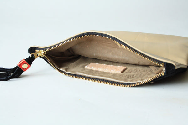silk lined leather clutch, handmade in canada