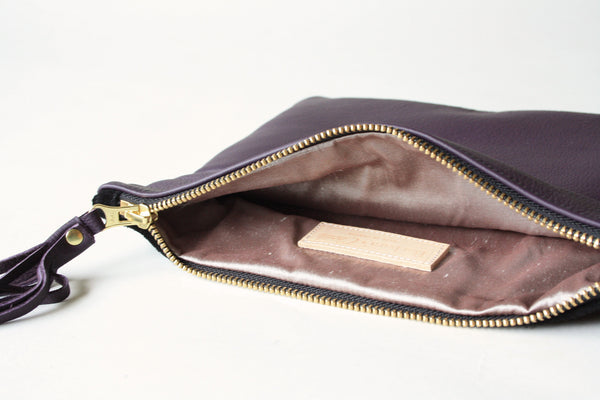silk lined handmade leather clutch